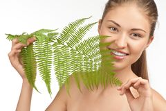 Beautiful woman with green leaf Stock Images
