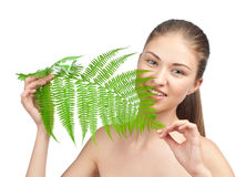 Beautiful woman with green leaf Stock Photo