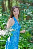 Beautiful woman among green leaves Royalty Free Stock Images