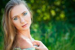 Beautiful woman among green leaves Royalty Free Stock Photo