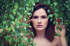 Beautiful Woman with Green Leaves Outdoors Stock Photography
