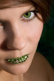 Beautiful woman with green lips Stock Photos