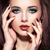 Beautiful woman with green make-up and creative nails Stock Image