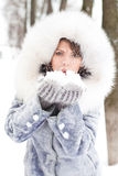 Winter woman Blowing Snow. Winter woman  in white furs blowing Snow Stock Photos