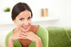 Beautiful woman in green shirt contemplating. While looking at the camera - copy space stock images