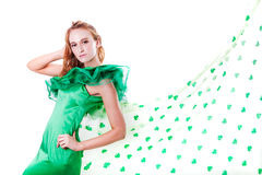 Beautiful Woman in Green and a shower of Shamrocks in March Stock Photos