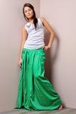 Beautiful woman in green skirt. Stock Photography