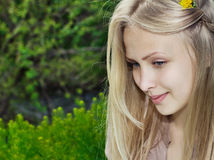 Beautiful woman on a green summer meadow Royalty Free Stock Photo