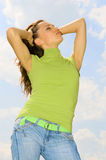 Beautiful woman in green T-shirt. Beautiful woman against blue sky Stock Photo