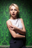 Beautiful woman in green vintage interior Royalty Free Stock Photography
