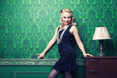 Beautiful woman in green vintage interior toned image Royalty Free Stock Photos