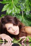 Beautiful woman in green wellnes Stock Images