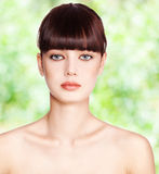Beautiful woman on green Royalty Free Stock Photography