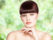 Beautiful woman on green Royalty Free Stock Photos