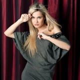Beautiful woman in a grey dress. Stock Photo
