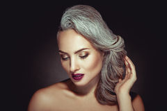Beautiful woman with grey hair color and nice makeup Royalty Free Stock Images