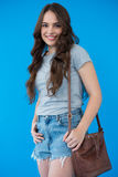 Beautiful woman in grey t-shirt with shoulder bag Royalty Free Stock Images
