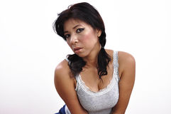 Beautiful woman grey top, pigtail, shows great cleavage Royalty Free Stock Images
