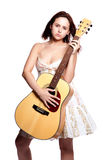 Beautiful woman with guitar Stock Image