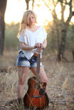 Beautiful Woman and Guitar Royalty Free Stock Images