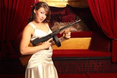 Beautiful woman with gun Royalty Free Stock Image