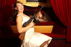 Beautiful woman with gun Stock Photo