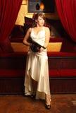 Beautiful woman with gun Stock Photography