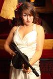 Beautiful woman with gun Royalty Free Stock Photos