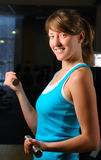 Beautiful woman in gym at evening Royalty Free Stock Photography