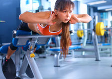 Beautiful woman at the gym exercising with her Stock Image