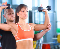 Beautiful woman at the gym exercising with her Royalty Free Stock Photo