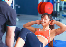 Beautiful woman at the gym exercising with her Stock Photo