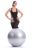 Beautiful woman in gym with fitness exercise ball Stock Image