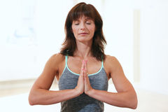 Beautiful woman at gym meditating Royalty Free Stock Photos