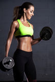 Beautiful woman at the gym Stock Images
