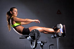 Beautiful woman at the gym. Portait of young adult sporty attractive sexy and sensuality beautiful brunette prety woman at the gym Royalty Free Stock Photos