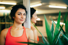 Beautiful woman in a gym, taking a break Royalty Free Stock Photo