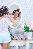 Beautiful woman in hair curlers Royalty Free Stock Photography