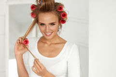 Beautiful Woman With Hair Curlers, Hair Rollers On Healthy Curly Royalty Free Stock Image