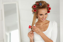 Beautiful Woman With Hair Curlers, Hair Rollers On Healthy Curly Royalty Free Stock Photography