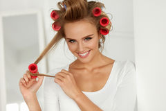Beautiful Woman With Hair Curlers, Hair Rollers On Healthy Curly Royalty Free Stock Photo