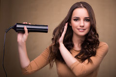 The beautiful woman with hair dryer. Beautiful woman with hair dryer royalty free stock photography