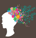 Beautiful woman with hair made of flowers Stock Photo