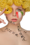 Beautiful woman with hair pasta and symbols of Italy Stock Photo