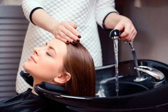 Beautiful woman in hair salon royalty free stock photos