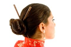 Beautiful woman with hair sticks Royalty Free Stock Image