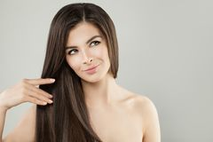 Beautiful Woman Hair Studio Portrait. Spa Girl. With Long Smooth Hair looking up Royalty Free Stock Photos