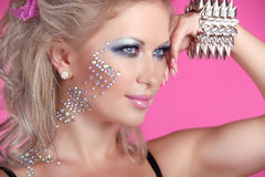 Beautiful woman with hair styling and evening make-up. Jewelry a Royalty Free Stock Images