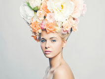 Beautiful woman with hairstyle of flowers Stock Image