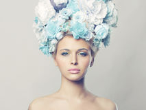 Beautiful woman with hairstyle of flowers Stock Photo